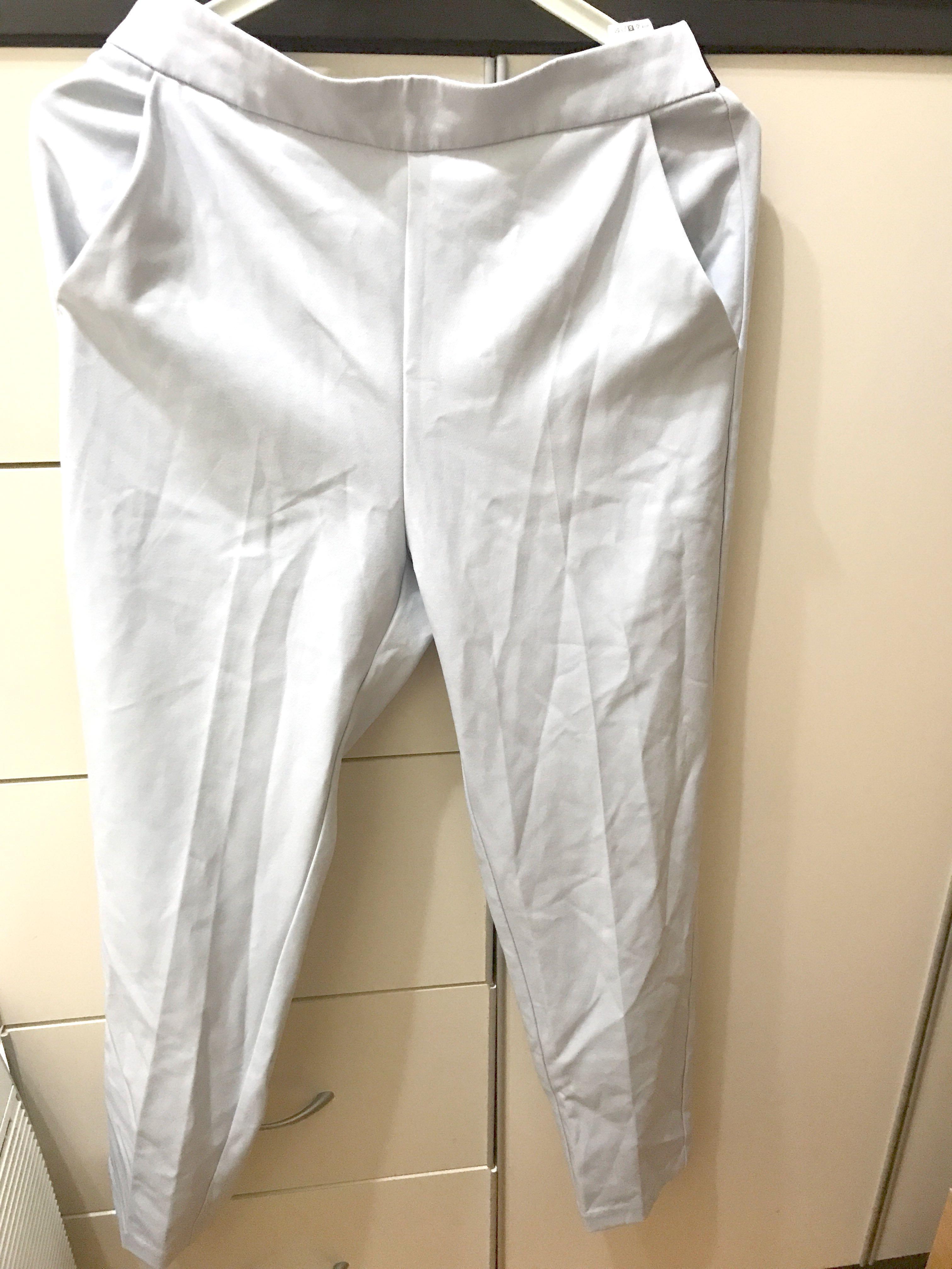 GU淺藍色彈性西裝褲