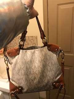 MK purse with long strap so u can wear it as a crossbody as well