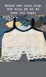 Lace crop TOP (Brand new )Suited for ladies XS  with black straps and black ribbons (new w tags )