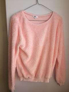 Furry pink jumper