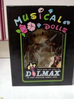 Wind up moving head musical doll