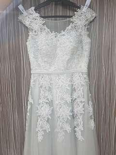 Formal gown with lace and beads details.