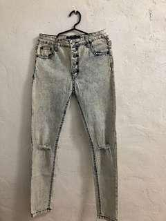 Pre-loved ripped jeans (b)
