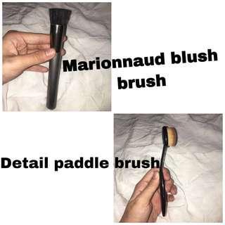 Take both makeup brushes