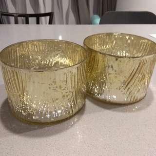 2 gold decorative holders
