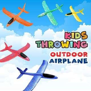 KIDS THROWING OUTDOOR AIRPLANE