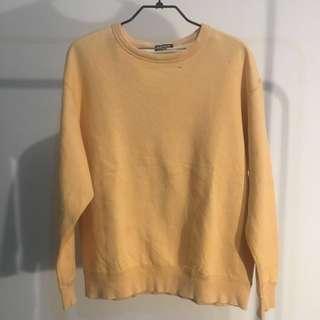 Uniqlo light orange sweater