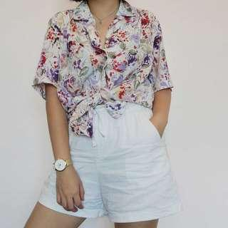 Vintage white blouse with floral patterns