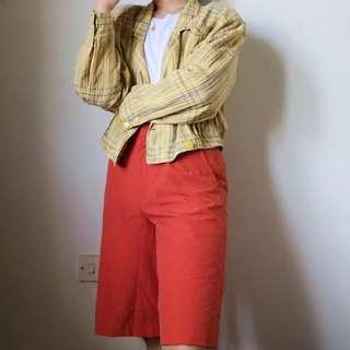 High-waisted orange shorts