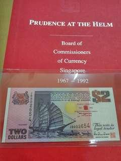 Singapore $2 Dollars Ship Prudence at the helm JB 002654 UNC with folder