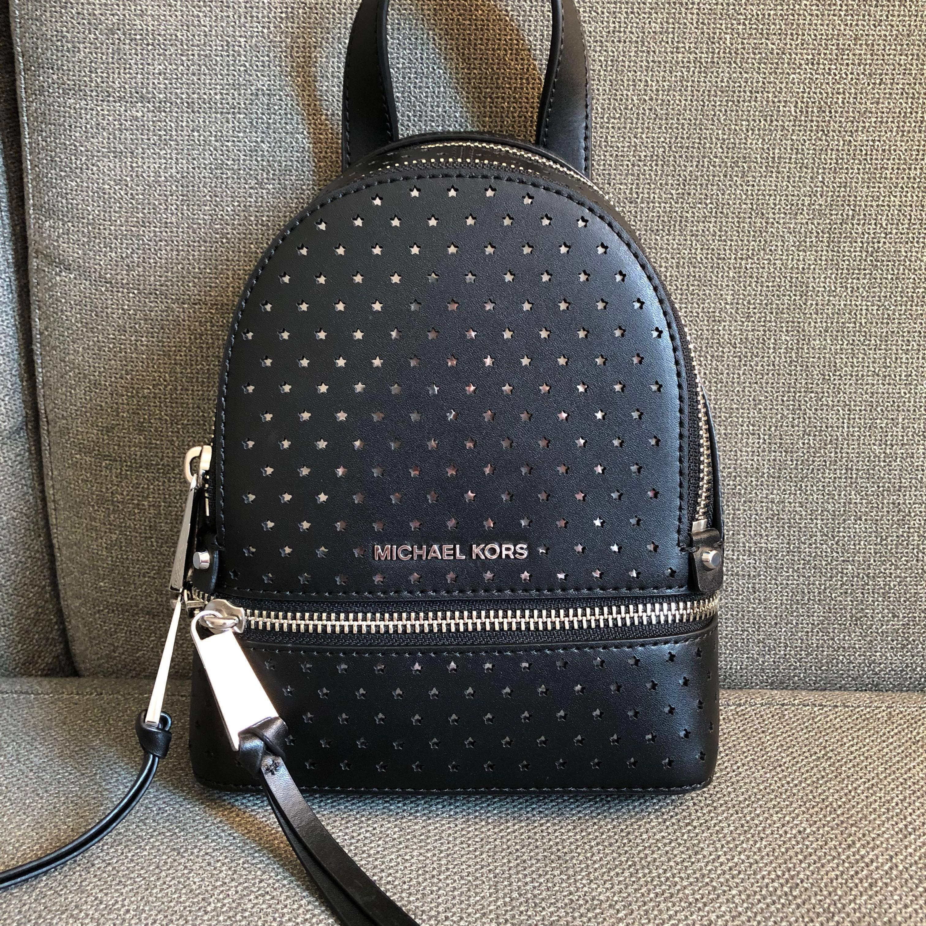 8569d8707632 Authentic Michel Kors Rhea Mini Star Shaped Perforated Crossbody Pearl  Black Leather Backpack on Carousell