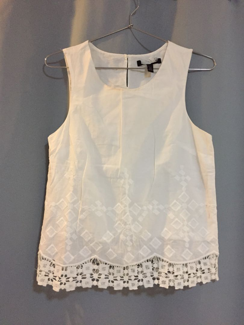 4158b1a526a485 White sleeveless blouse with lace trim