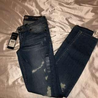 Guess jeans mid wash distressed