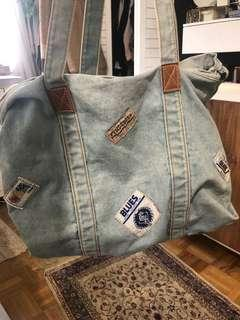 Denim bag with patches