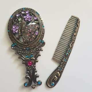 Antique hand mirror and comb
