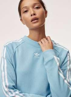 adidas TRF Crew Sweater from Aritzia