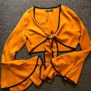 Princess Polly orange tie up top size 10-12