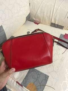 Red sling bag big minor defect