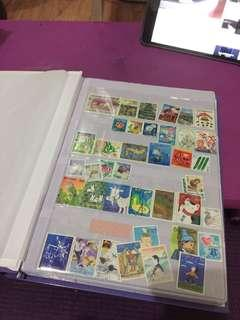 old / vintage Postage Stamps with Album