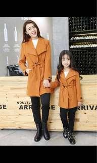 Matching jacket mom and daughter