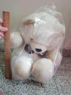 Wrapped white furry bear