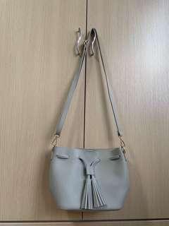 grey bucket sling bag