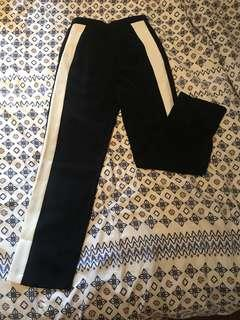Pomelo. Black wide pants with white stripes M