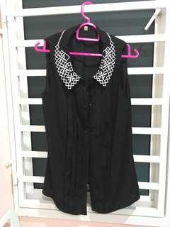 Black sleeveless blouse