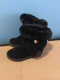 Size 6 women's brand new winter boots never worn with gold accent and tassels with side Velcro closure