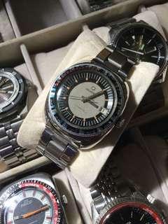 Vintage reusser diver winding watch
