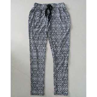 White background long cotton flower design pants for sale