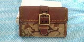 Coach wallet auth.