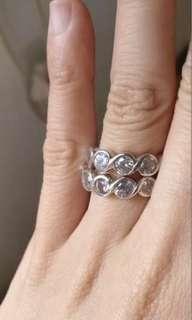 White sapphire half eternity ring