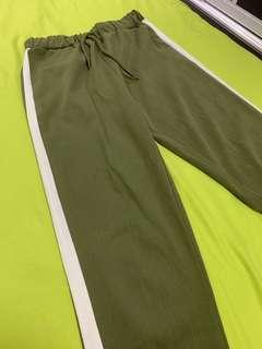 Army green olive jogger pants with white stripe panel at the side