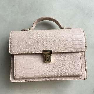 Pastel pink leather sling bag