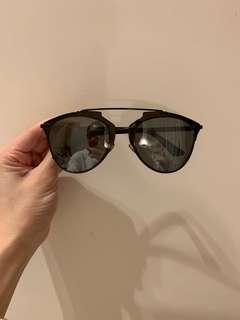 Dior sunglasses (model: reflected)