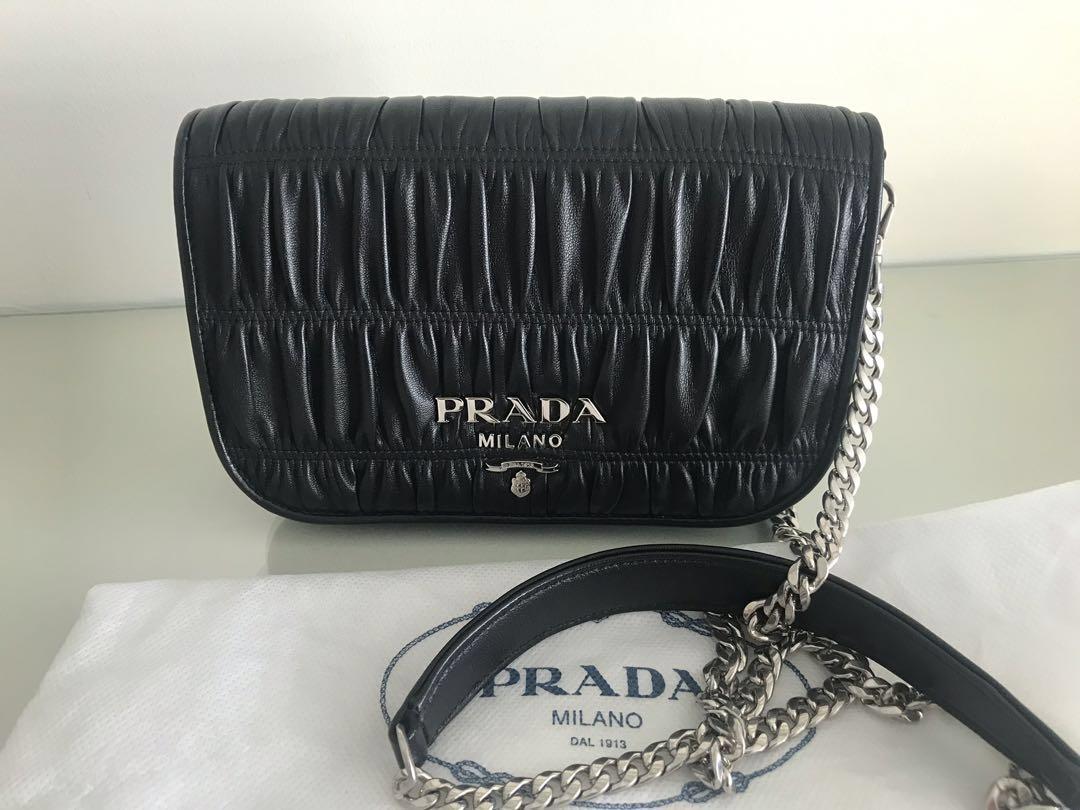 a86bc4c2a716 Prada leather sling bag