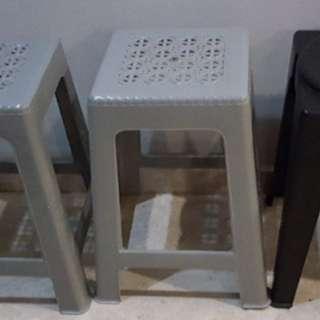 Grey plastic stools
