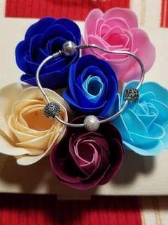 Essence bracelet with charms