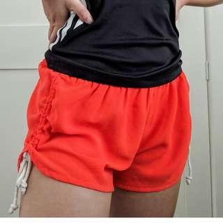 Minkpink orange side tie shorts