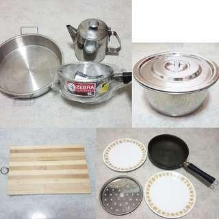 $10 to $20 Sauce pot + round steam tray + water jar + chopping board + frying pan + plate