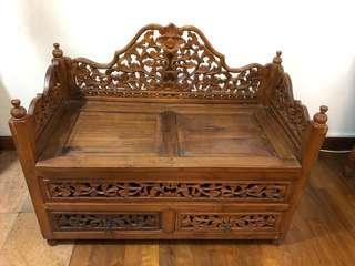 Vintage antique wooden bench with storage below