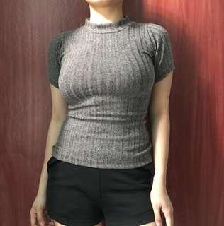 Knitted turtleneck blouse