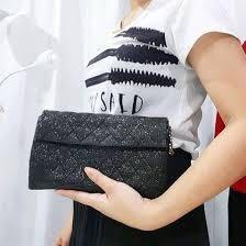 Authentic Chanel black iridescent limited edition WOC evening bag with chain