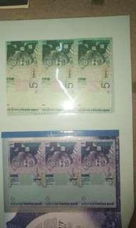 Uncut banknotes rm1 and rm5
