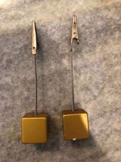 gold cubic paper clip