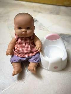 Baby with baby carrier and potty