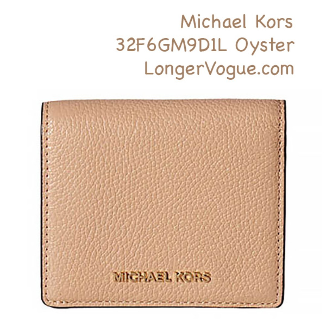 c6619074bb42 MK Michael Kors leather wallet, Luxury, Bags & Wallets on Carousell