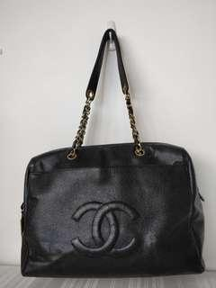 Authenticated Chanel black zip top bag with Chanel charm
