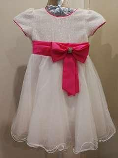 Little white dress with pink ribbon